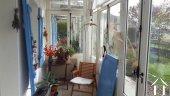 Entrance through a conservatory