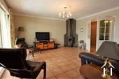 cosy salon with underfloor heating and wood-burner