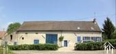 Gerenoveerde woonboerderij met groot atelier en bijgebouwen
