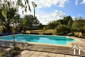 attractive gardens beyond the pool area