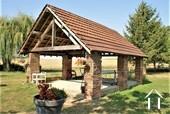 <en>sheltered terrace in the garden</en><fr>terrasse ombragée dans le jardin</fr>