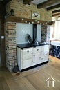wood stove in kitchen that heats the house