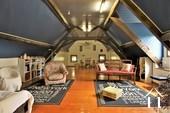 <en>large second salon in the attic</en><fr>grande second salon à l'étage</fr>